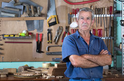 Portrait of man at work in workshop in garage at home Stock Photo