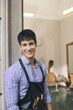 Portrait of man working as hairdresser and smiling Stock Photos