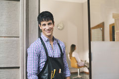 Portrait of man working as hairdresser and smiling Stock Photography