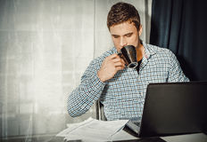 Portrait of man working in home office stock image