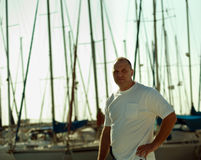 Portrait of a man on a yacht . Portrait of a man on a yacht at the yacht club royalty free stock photo
