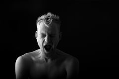 Portrait of a man yawning on black background Royalty Free Stock Image