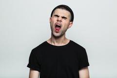 Portrait of man yawning. Royalty Free Stock Image