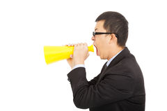 Portrait of a man yelling Into A Megaphone. Portrait of asian man yelling Into A Megaphone on white Royalty Free Stock Photos
