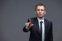 Portrait of manager pointing hand gestures Royalty Free Stock Photography