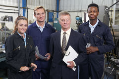 Portrait Of Manager And Staff In Engineering Factory stock photography