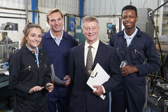 Portrait Of Manager And Staff In Engineering Factory Royalty Free Stock Photo