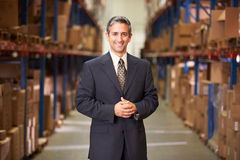 Portrait Of Manager In Warehouse. Smiling o Camera royalty free stock image