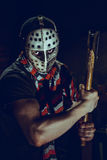 Portrait of Maniac with axe in dark basement Stock Photos
