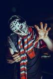 Portrait of Maniac with knife in dark basement Royalty Free Stock Photos