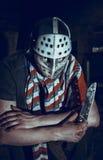 Portrait of Maniac with knife in dark basement Stock Photo