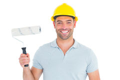Portrait of manual worker holding paint roller. On white background Stock Image