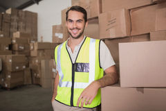 Portrait of manual worker in warehouse. Portrait of manual worker standing in the warehouse stock images