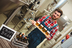 Portrait of manufacturer holding beer samples Royalty Free Stock Image