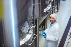 Portrait of manufacturer standing at brewery Stock Photography