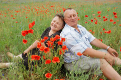 Portrait marriage couple. In the poppy field stock image
