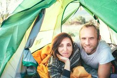 Portrait of Marriage couple meet morning in the green color tent. Smiling people concept photo stock photos