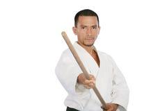 Portrait of martial arts man in kimono excercise. Closeup isolated portrait of martial arts man in kimono excercising karate kata Stock Photos