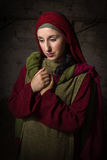 Portrait of Mary of Magdalene. Portrait of a model in biblical clothing during a bible scene acting as Mary Magdalene or the virgin Mary Royalty Free Stock Photography