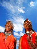 Portrait of Masai Mara male warriors. AFRICA, KENYA, MASAI MARA, NOVEMBER 12: portrait on an African guys of Masai Mara tribe village over blue sky, review of Royalty Free Stock Photo