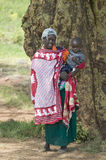 Portrait of Masai Mother and Baby in traditional red toga at Lewa Wildlife Conservancy in North Kenya, Africa Stock Image