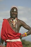 Portrait of Masai Warrior in traditional red toga and beads at Lewa Wildlife Conservancy in North Kenya, Africa Royalty Free Stock Images