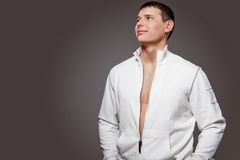 Portrait of Masculine Strong Tanned Caucasian Man in White Jacke Royalty Free Stock Photo