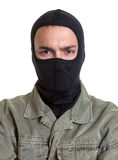 Portrait of a masked burglar. On an isolated white background for cutout royalty free stock photography