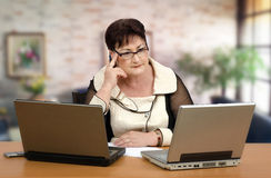 Portrait of math online tutor. Portrait of middle-aged woman giving individualized online tutoring of math Stock Photography