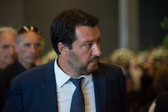 Portrait of Matteo Slavini in a suit meeting with civilians royalty free stock image