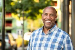 Happy mature African American man smiling outside. Royalty Free Stock Image