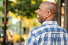 Happy mature African American man smiling outside. Royalty Free Stock Photos