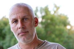 Portrait of a mature bald man. A portrait of a mature bald man royalty free stock photography