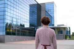Rear View Of Mature Businesswoman Looking At The View Of The City stock photos