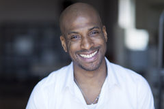 Portrait Of A Mature Black Man Smiling At The Camera. Royalty Free Stock Photo