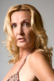 Portrait of mature blond woman. Headshot of mature blond woman Royalty Free Stock Photos