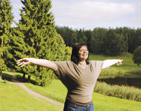 Portrait of mature brunette woman enjoing sun. Outside in park, autumn nature Royalty Free Stock Images