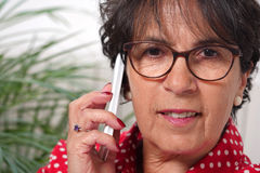 Portrait of mature brunette woman talking on phone Royalty Free Stock Photos