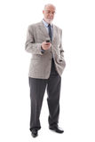 Portrait of mature business man. With cellphone isolated on white background royalty free stock images