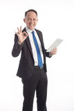 Portrait of a mature businessman with digital tablet on white ba Royalty Free Stock Photos