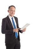 Portrait of a mature businessman with digital tablet Royalty Free Stock Photos