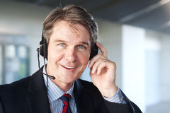 Portrait of a mature businessman with headset Stock Images
