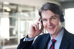 Portrait of a mature businessman with headset Royalty Free Stock Image