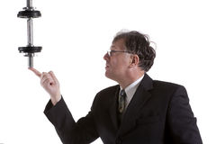 Portrait Of Mature Businessman Lifting Barbell Royalty Free Stock Photography