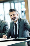 Portrait of mature businessman in meeting Royalty Free Stock Image