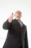 Portrait of a mature businessman offering handshake Stock Image