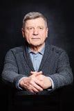 Portrait of Mature Businessman. Senior Man on Black Stock Photo