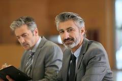 Portrait of mature businessmen in meeting Stock Photo