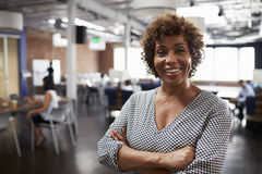 Portrait Of Mature Businesswoman In Modern Open Plan Office Royalty Free Stock Photos
