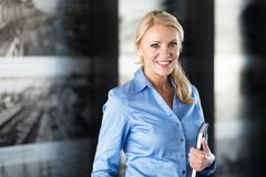 Portrait Of A Mature Businesswoman Smiling At The Camera Royalty Free Stock Photography